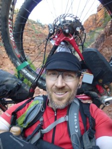Hiking the Grand Canyon with my bike and gear strapped to my back.